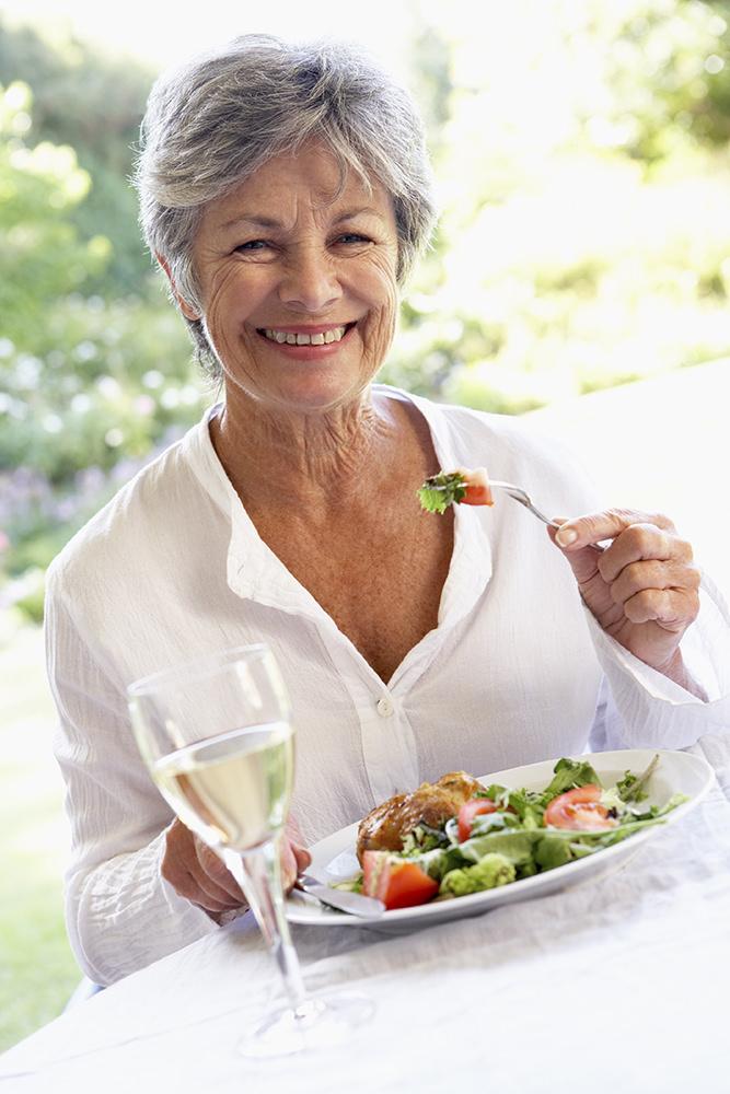 Senior Woman Eating An Al Fresco Lunch